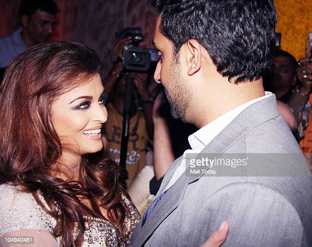 Aishwarya Rai with Abhishek Bachchan at Day I of the HDIL Couture fashion week in Mumbai on October 6 2010