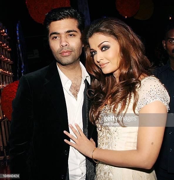 Aishwarya Rai with Karan Johar at Day I of the HDIL Couture fashion week in Mumbai on October 6 2010