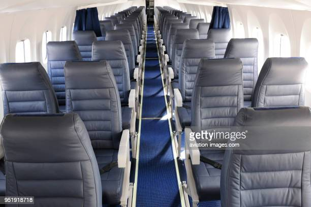 Aisle and empty passenger cabin seats on AirBaltic Bombardier DHC8 Q400 Next Generation parked in the staticdisplay at the SingaporeAirshow 2010