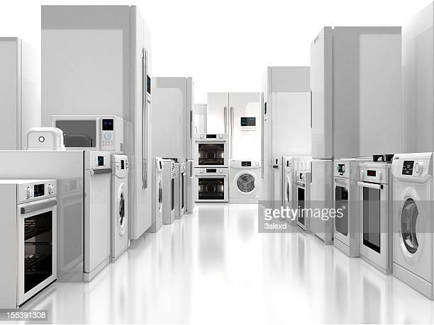 Aisle with white appliances on both sides and shiny floor