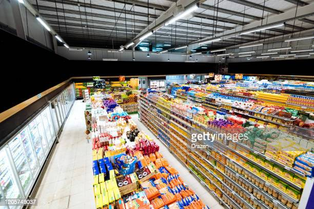 aisles and shelves in supermarket, wide angle view - aisle stock pictures, royalty-free photos & images