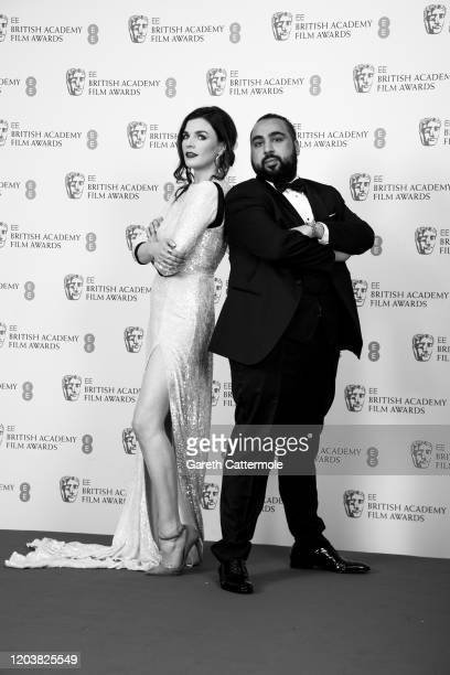 Aisling Bea and Asim Chaudhry pose in the Winners Room during the EE British Academy Film Awards 2020 at Royal Albert Hall on February 02 2020 in...