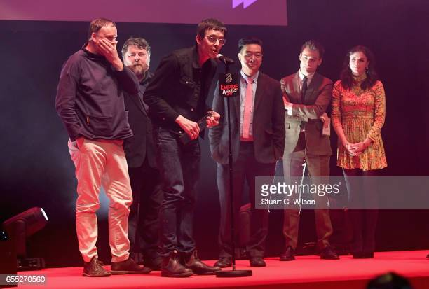 Aisling Bea and Douglas Booth present the award for Best Comedy to Andy Hung Jim Hosking Ben Wheatley and Andy Starke for the film The Greasy...
