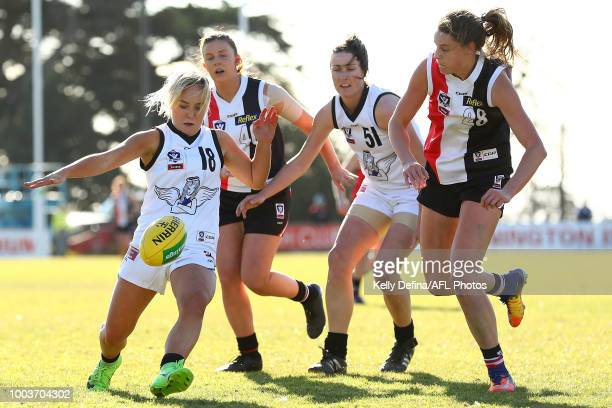 Katie Angelis of Melbourne Uni kicks the ball during the round 11 VFLW match between the Southern Saints and Melbourne Uni at SkyBus Stadium on July...