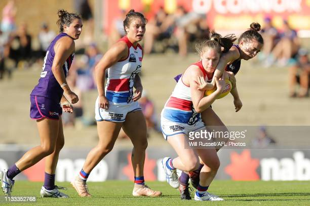 Aisling Utri of the Bulldogs is tackled by Laura Pugh of the Dockers during the round five AFLW match between the Fremantle Dockers and the Western...