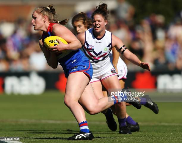 Aisling Utri of the Bulldogs runs with the ball during the round one AFLW match between the Western Bulldogs and the Fremantle Dockers at Whitten...