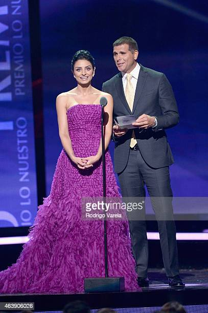 Aislinn Derbez and Christian Meier speak onstage at the 2015 Premios Lo Nuestros Awards at American Airlines Arena on February 19 2015 in Miami...