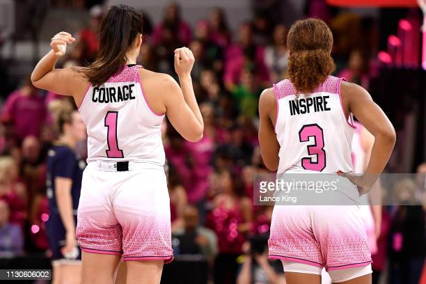 Aislinn Konig and Kai Crutchfield of the North Carolina State Wolfpack look on in the second half of their game against the Notre Dame Fighting Irish...