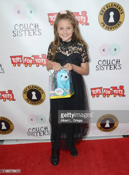 Aislinn Plair attends The Couch Sisters 1st Annual Toys For Tots Toy Drive held onNovember 20 2019 in Glendale California