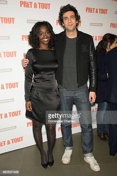 Aissa Maiga and Max Boublil attend the 'Pret A Tout' Paris Premiere at Cinema Gaumont Marignan on January 13 2014 in Paris France
