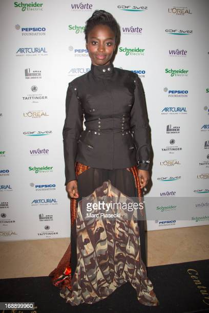 Aissa Maiga attends the 'Planet Finance' dinner photocall at the 'Carlton' hotel during the 66th annual Cannes Film Festival on May 16 2013 in Cannes...