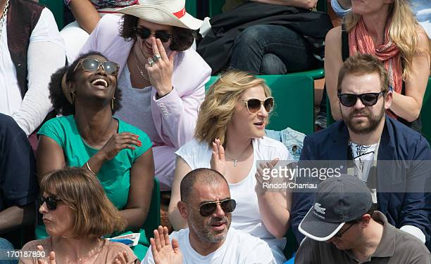 Aissa Maiga Marilou Berry and companion Arnaud Schneider at Roland Garros on June 8 2013 in Paris France