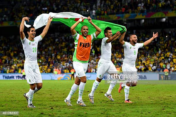 Aissa Mandi and players of Algeria celebrate qualifying for the knock out stage after the 11 draw in the 2014 FIFA World Cup Brazil Group H match...