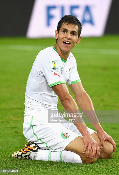 Aissa Mandi of Algeria celebrates after a 11 draw during the 2014 FIFA World Cup Brazil Group H match between Algeria and Russia at Arena da Baixada...