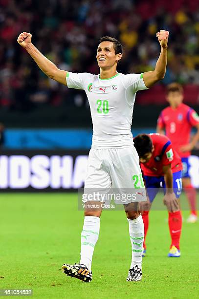 Aissa Mandi of Algeria celebrates after defeating South Korea 42 during the 2014 FIFA World Cup Brazil Group H match between South Korea and Algeria...