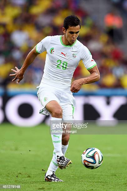 Aissa Mandi of Algeria controls the ball during the 2014 FIFA World Cup Brazil Group H match between Algeria and Russia at Arena da Baixada on June...