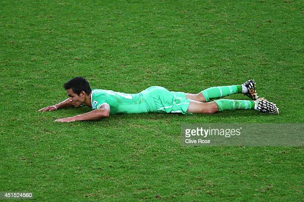 Aissa Mandi of Algeria lies on the field after being defeated by Germany 21 during the 2014 FIFA World Cup Brazil Round of 16 match between Germany...