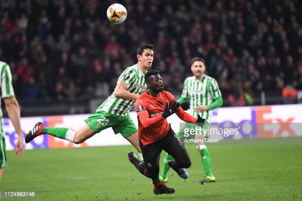 Aissa Mandi of Real Betis and Mbaye Niang of Rennes during the UEFA Europa League Round of 32 First Leg match between Rennes and Real Betis at...