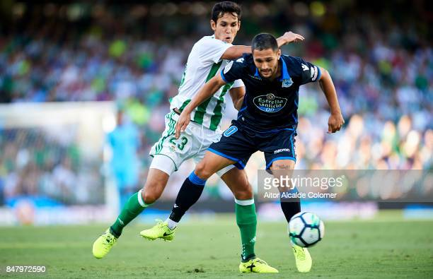 Aissa Mandi of Real Betis Balompie competes for the ball with Florin Andone of RC Deportivo during the La Liga match between Real Betis and Deportivo...