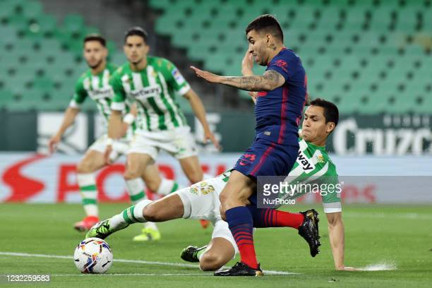 Aissa Mandi of Real Betis Balompie in action with Angel Correa of Atletico de Madrid during the La Liga Santander match between Real Betis and...