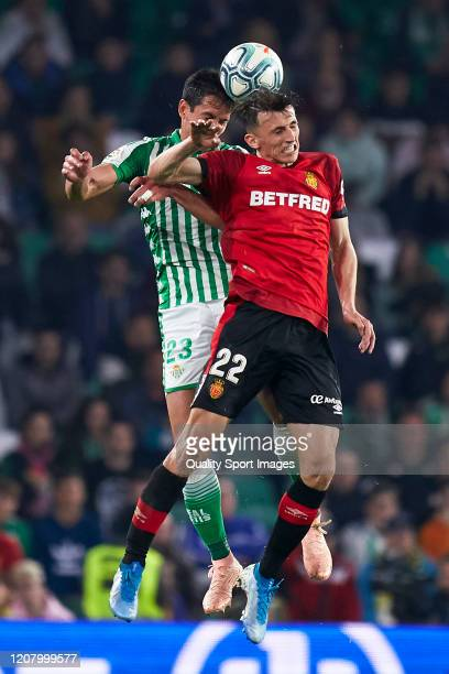 Aissa Mandi of Real Betis competes for the ball with Ante Budimir of RCD Mallorca during the La Liga match between Real Betis Balompie and RCD...