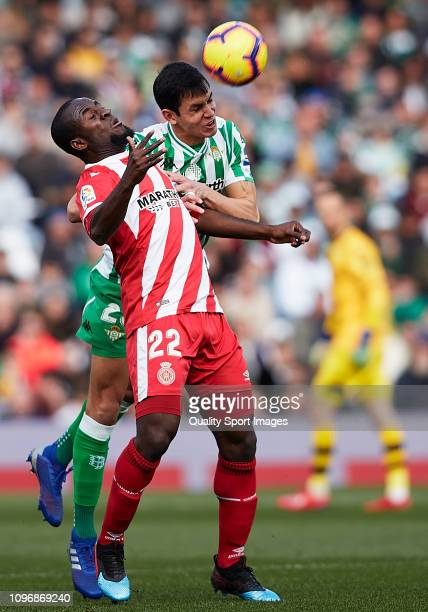 Aissa Mandi of Real Betis competes for the ball with Seydou Doumbia of Girona FC during the La Liga match between Real Betis Balompie and Girona FC...