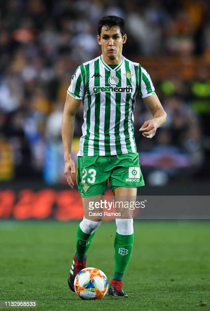 Aissa Mandi of Real Betis runs with the ball during the Copa del Semi Final match second leg between Valencia and Real Betis at Estadio Mestalla on...