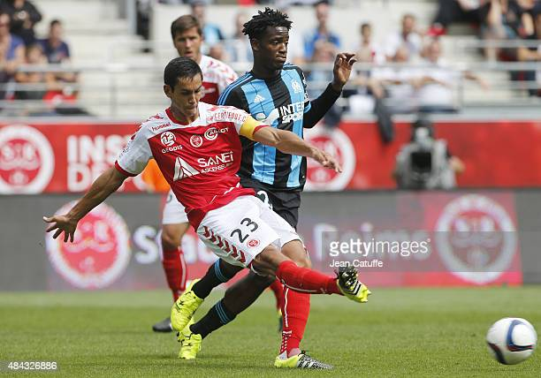 Aissa Mandi of Stade de Reims and Michy Batshuayi of OM in action during the French Ligue 1 match between Stade de Reims and Olympique de Marseille...