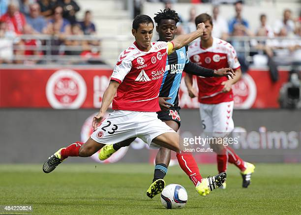 Aissa Mandi of Stade de Reims in action during the French Ligue 1 match between Stade de Reims and Olympique de Marseille at Stade Auguste Delaune on...