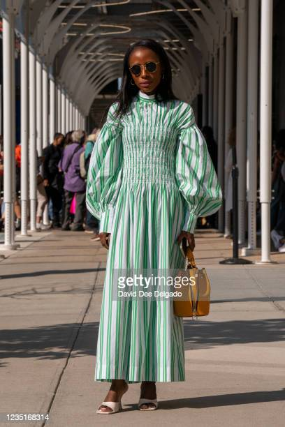 Aissata Kourouma is seen wearing a dress by Ganni with a hand bag and shoes by Zara at Spring Studios during New York Fashion Week on September 10,...