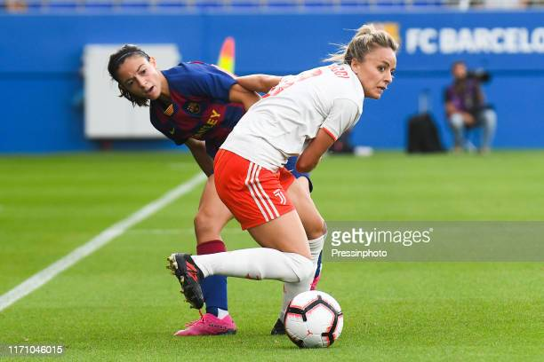 Aitana Bonmati of FC Barcelona and Martina Rosucci of Juventus during the Women'S UEFA Champions League 1/16 second leg match between Barcelona and...