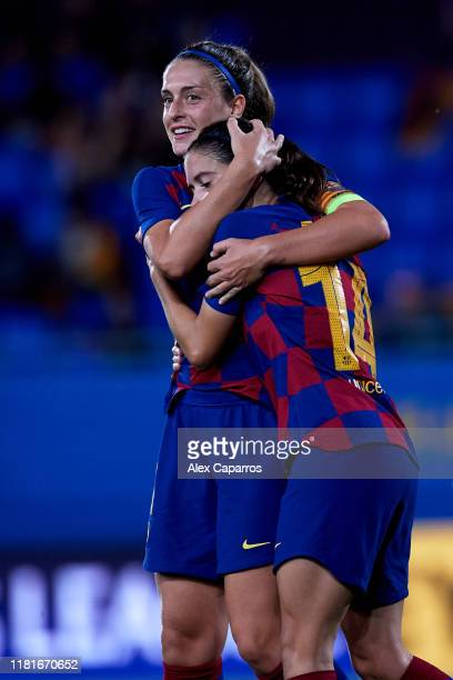 Aitana Bonmati of FC Barcelona celebrates with her teammate Alexia Putellas after scoring her team's third goal during the UEFA Women's Champions...
