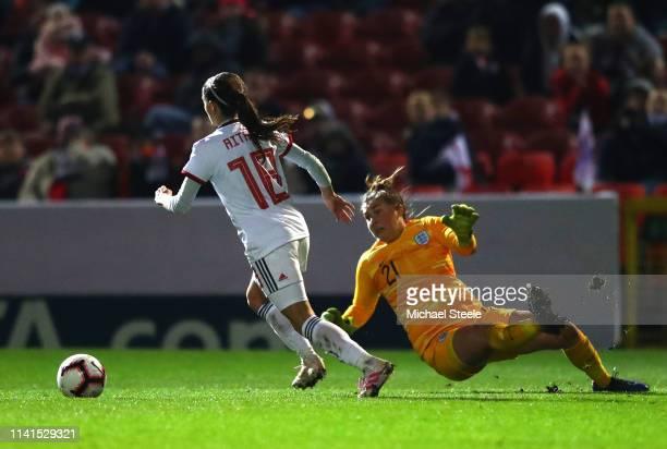 Aitana Bonmati of Spain takes the ball past Mary Earps of England during the International Friendly between England Women and Spain Women at County...
