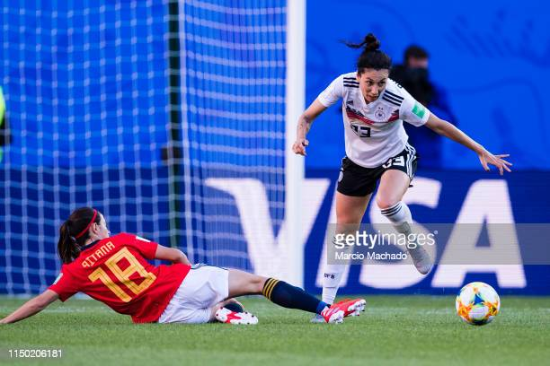 Aitana Bonmati of Spain trips up with Sara Doorsoun of Germany during the 2019 FIFA Women's World Cup France group B match between Germany and Spain...