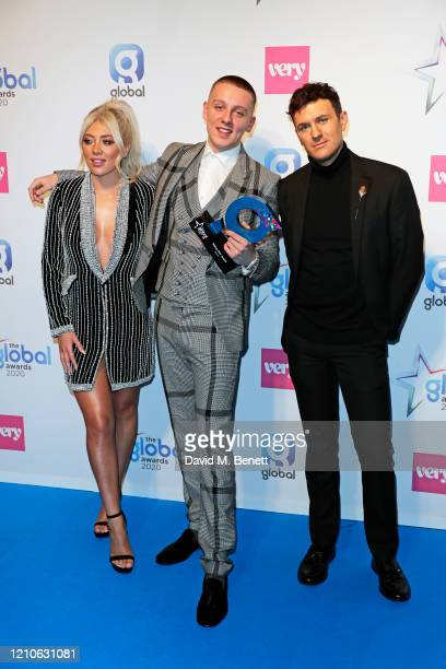 Aitch winner of Rising Star Award poses with Paige Turley and Jimmy Hill in the Winners Room during The Global Awards 2020 at the Eventim Apollo...