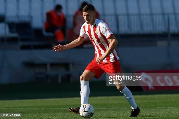 Aitor Bunuel of Almeria controls the ball during the La Liga Smartbank match between UD Almeria and UD Las Palmas at Estadio Juegos del Mediterraneo...
