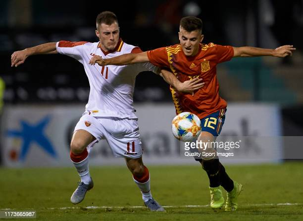 Aitor Bunuel of Spain competes for the ball with Aija Krnic of Montenegro during the 2019 UEFA European Under-21 Championship match between Spain and...