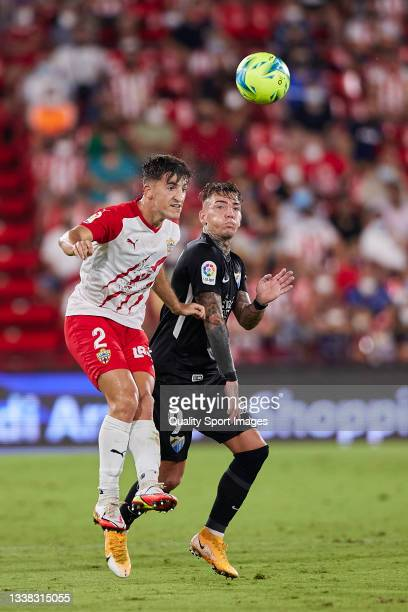 Aitor Bunuel of UD Almeria competes for the ball with Brandon Thomas of Malaga CF during the Liga Smartbank match betwen UD Almeria and Malaga CF at...