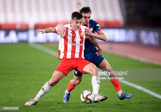 Aitor Bunuel of UD Almeria competes for the ball with Munir El Haddadi of Sevilla FC during the Copa del Rey Quarter-Final match between UD Almeria...