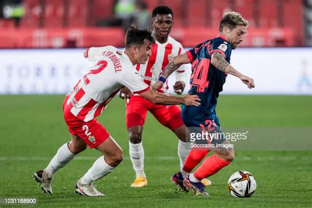 Aitor Bunuel of UD Almeria, Papu Gomez of Sevilla FC during the Spanish Copa del Rey match between UD Almeria v Sevilla at the Estadio de los Juegos...