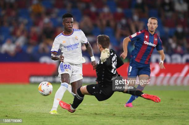 Aitor Fernandez of Levante is shown a red card and sent off for handball after this incident with Vinicius Junior of Real Madrid during the LaLiga...