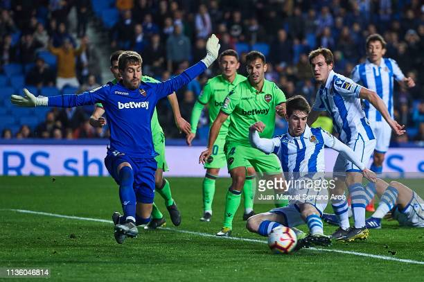 Aitor Fernandez of Levante UD blocks a shoot from Aritz Elustondo of Real Sociedad during the La Liga match between Real Sociedad and Levante UD at...