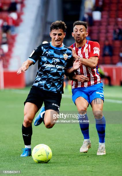 Aitor Garcia of Real Sporting de Gijon duels for the ball with Aitor Bunuel of UD Almeria during the Liga Smartbank match betwen Real Sporting and UD...