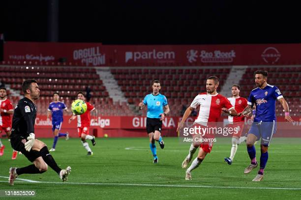 Aitor Garcia of Real Sporting misses a chance to score against goalkeeper Juan Carlos Martin and Enric Franquesa of Girona FC Girona FC during the...