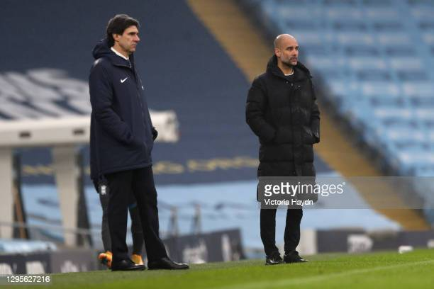 Aitor Karanka, manager of Birmingham City and Pep Guardiola, Manager of Manchester City watch on during the FA Cup Third Round match between...