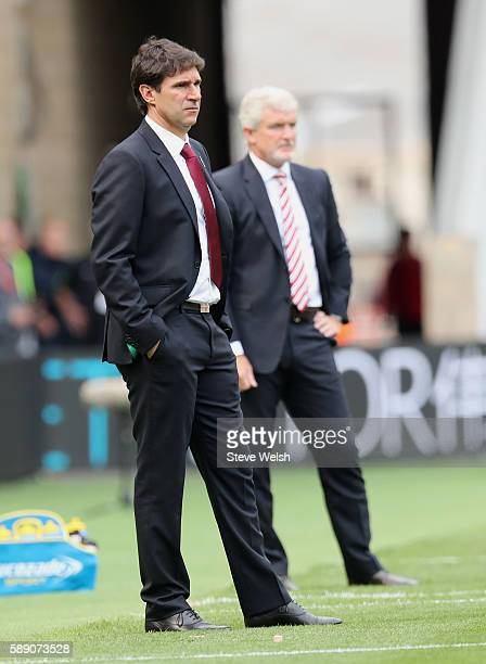 Aitor Karanka Manager of Middlesbrough and Mark Hughes Manager of Stoke City look on during the Premier League match between Middlesbrough and Stoke...