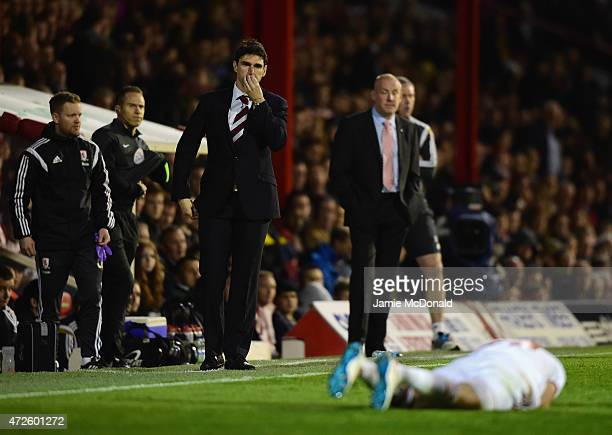 Aitor Karanka manager of Middlesbrough and Mark Warburton manager of Brentford look on as Patrick Bamford of Middlesbrough is injured during the Sky...
