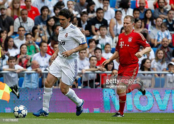 Aitor Karanka of Real Madrid is chased by Stefan Reuter of Bayern Muenchen during the Corazon Classic Match between Allstars Real Madrid and Allstars...