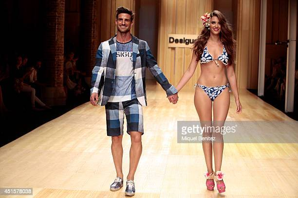 Aitor Ocio and Clara Alonso walk the runway during the Desigual show as part of the 080 Barcelona Fashion Spring/Summer 2015 on July 1 2014 in...