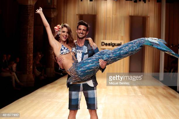 Aitor Ocio carries Clara Alonso on the runway during the Desigual show as part of the 080 Barcelona Fashion Spring/Summer 2015 on July 1 2014 in...